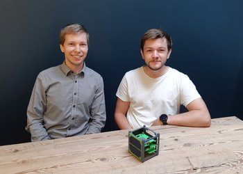 Hogne Andersen (left) and Mats Heigre from Dynaspace, with a model of a satellite that could provide better data to the shrimp farming industry.