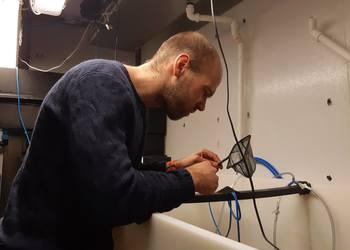 Tarald Kleppa Øvrebø checks on ShrimpVision's first batch of king prawns, at the High Technology Centre in Bergen.